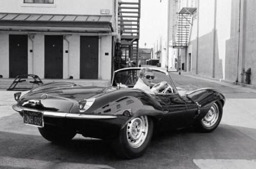 Steve McQueen in black jaguar at studio