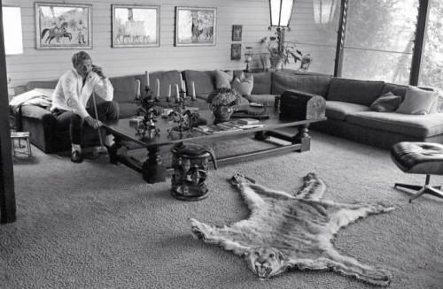Steve McQueen talking on the phone in living room